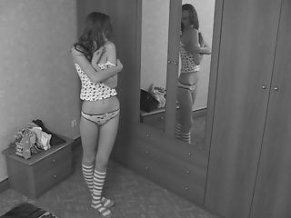 As this teen changes clothes, trying to figure out what to wear, there`s a voyeur video camera that`s secretly filming her.