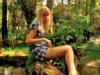 Danielka loves to go out to the stream behind her house just as the sun is going down and sit by the water. Thats not all Danielka likes to do though, she just cant keep her fingers off her tight body! As she sits there by the water in the warm afternoon