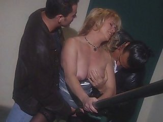 Mature blonde has cocks inside her