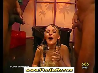 Piss drinking babe gets goldenshower in watersports gangbang