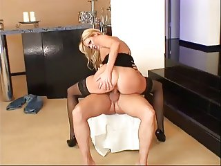 hot blonde in stockings and high heels gets fucked