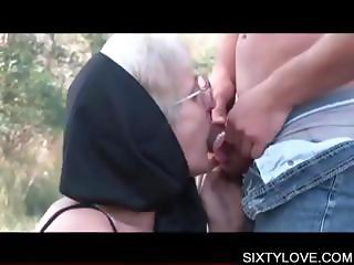 Mature lover taking young dick on knees