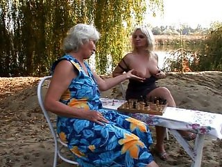 Granny stuffing by the lake