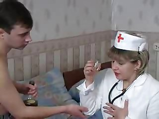 Mature doctor is sucking a cock of her pacient