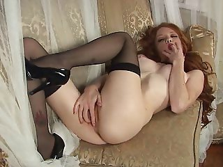 Sexy Redhead in stockings & high heels