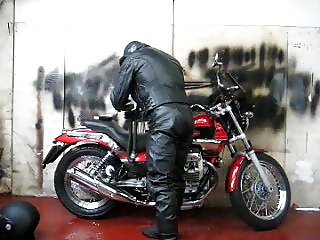 leather and rubber masked motorcycle wank