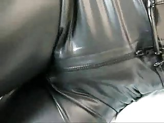 Girl in Rubber with Bag on Head and Vibrator