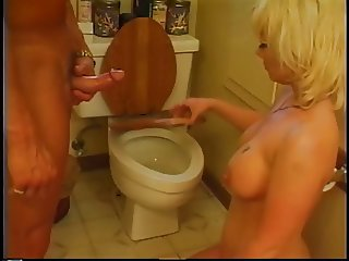 Busty blonde whore takes anal pounding on toilet
