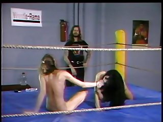 Naked Girls in boxing ring oiled up