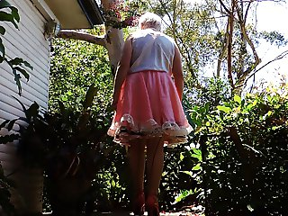 sissy ray outdoors in pink sissy dress