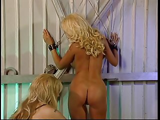 Big tits blonde captured as a slave