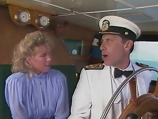 Candy Evans and John Leslie on a boat....