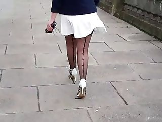 White pleated skirt and stockings