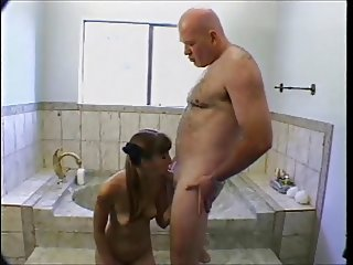 Old guy fucks young girl in bathroom