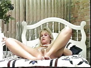 Blond whore massaging her cunt with her fingers