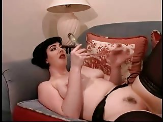 Jacqueline Undresses And Dildos Her Creamy Puss