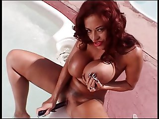 Busty ebony bitch shows her huge jugs and plays with dildo