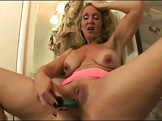 mature playing with dildo
