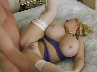 Blonde MILF with giant boobs having pussy breakfast