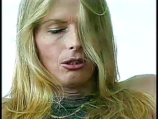 Blonde tranny grabs her tits while getting her cock sucked