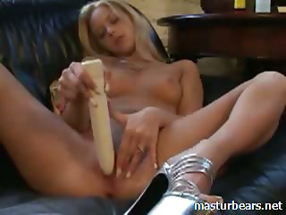 Blondie Emma dildoing on the couch