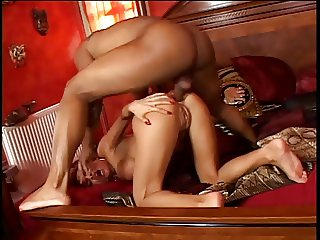 Two whores jump all over a stiff black cock and do BJ