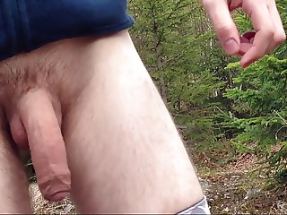 Teen boy taking his penis out in the forest for some air