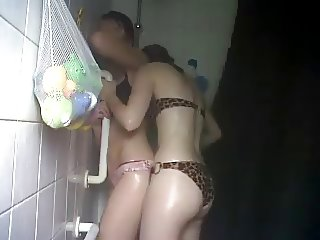 Nikki and Amy showering in bikinis