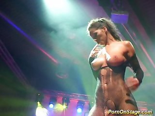 Busty sex show on public stage