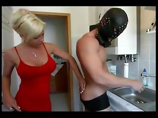 Busty mistress blows her slaves dick