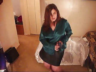 Wife Strips to music in a Green and Black satin outfit.