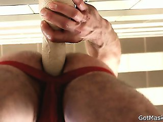 Pierced hunk stuffing his anus part2