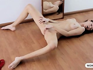 Teen Elly pleasuring infront of a mirror