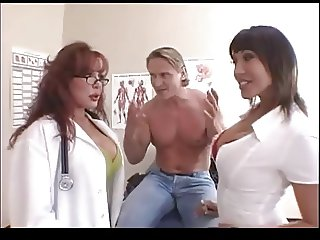 2 Female Doctors Take On Their Muscular Patient.
