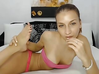 Flexible webcam girl sucks her feet