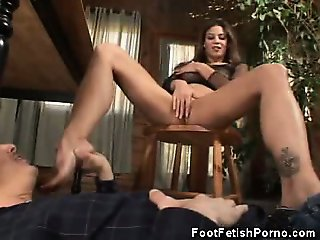 Babe In Fishnets Gives A Footjob And A Blowjob