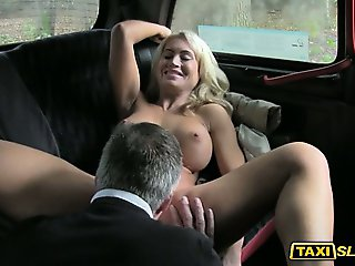 Busty Phoebe facialized by cab driver