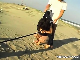 Jap school babe held as sex slave pissing on the beach