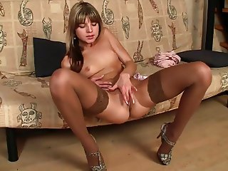Cute Teen In Stockings Tasting Her Pussy