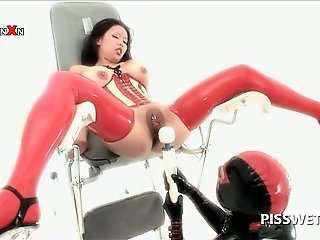 BDSM asian sex slave in latex gets cunt tortured for piss