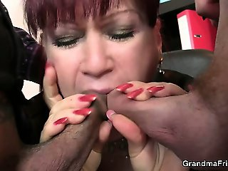 Hot business lady takes two dicks