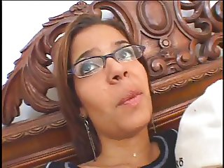 Glasses wearing Latina strips and shows her nice ass and small perky tits