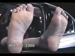Cute woman has gigantic feet. Classic