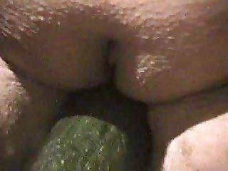 BBW wife inserts Cucumber in pussy while standing