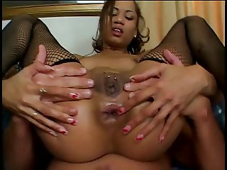 Perfect young exotic girl in fishnets takes on two big dicks in all her holes
