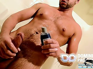 We join the muscled stud Dominic in the shower as he sinks