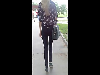 Voyeur nice ass in tight shiny jeans
