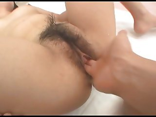 Playing with the pussy of a young japanese girl