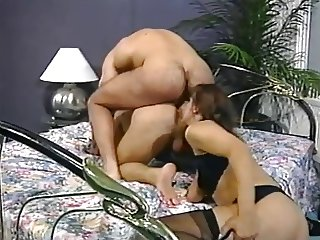 Andrea is licking two mens assholes