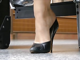 Sexy MILF Dangling At Airport